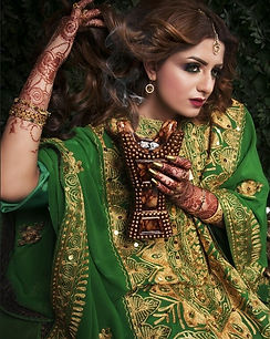 Model Posing for a Shoot in Green Saree