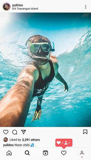 Diver under sea using GoPro.jpg