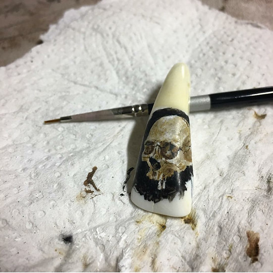 Skull on Bison tooth