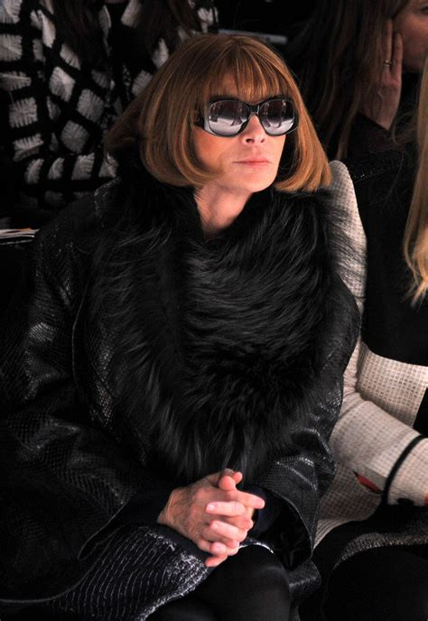 Anna Wintour sitting  front row at fashion week.