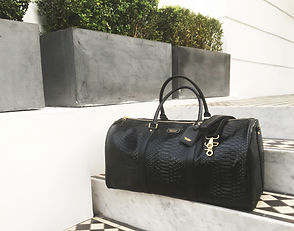 Python leather sovereign holdall luxe accessories collection