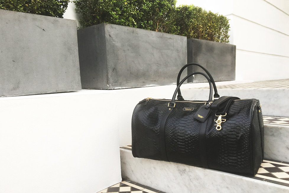 Luxe accessory sovereign holdall in python leaher
