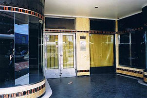 Art Deco tiling and curved display cases flank the Parramatta Road entrance