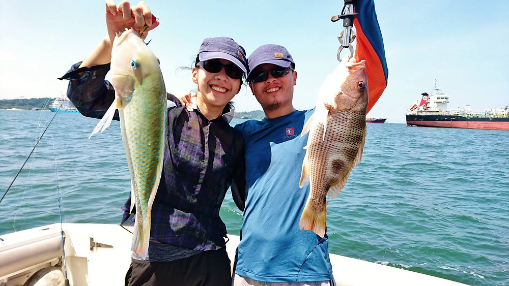 Couple with tuskfish and snapper