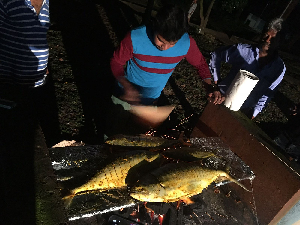 man barbecuing queenfish