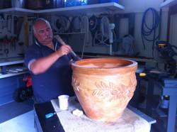 Sam adding rustic decoration