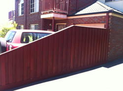 Fence Repaired and Stained