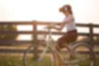 girl-wearing-vr-box-driving-bicycle-duri