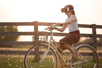 girl-wearing-vr-box-driving-bicycle-duri