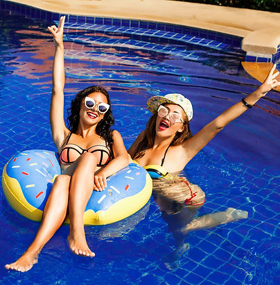 Girls lounging in a pool