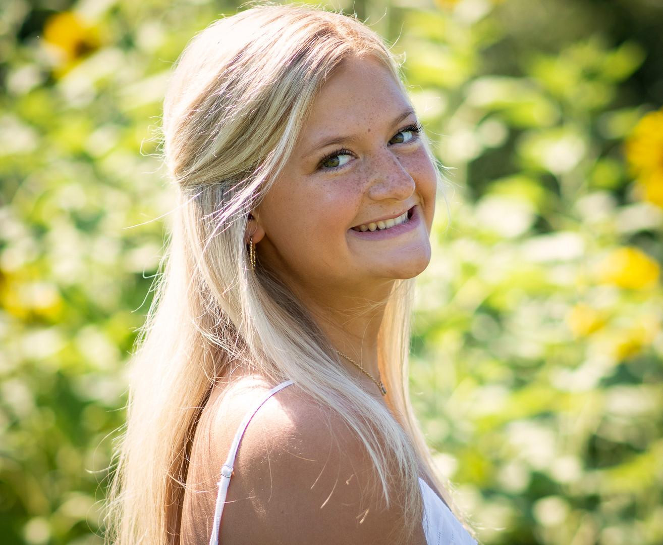 high school senior girl with flowers