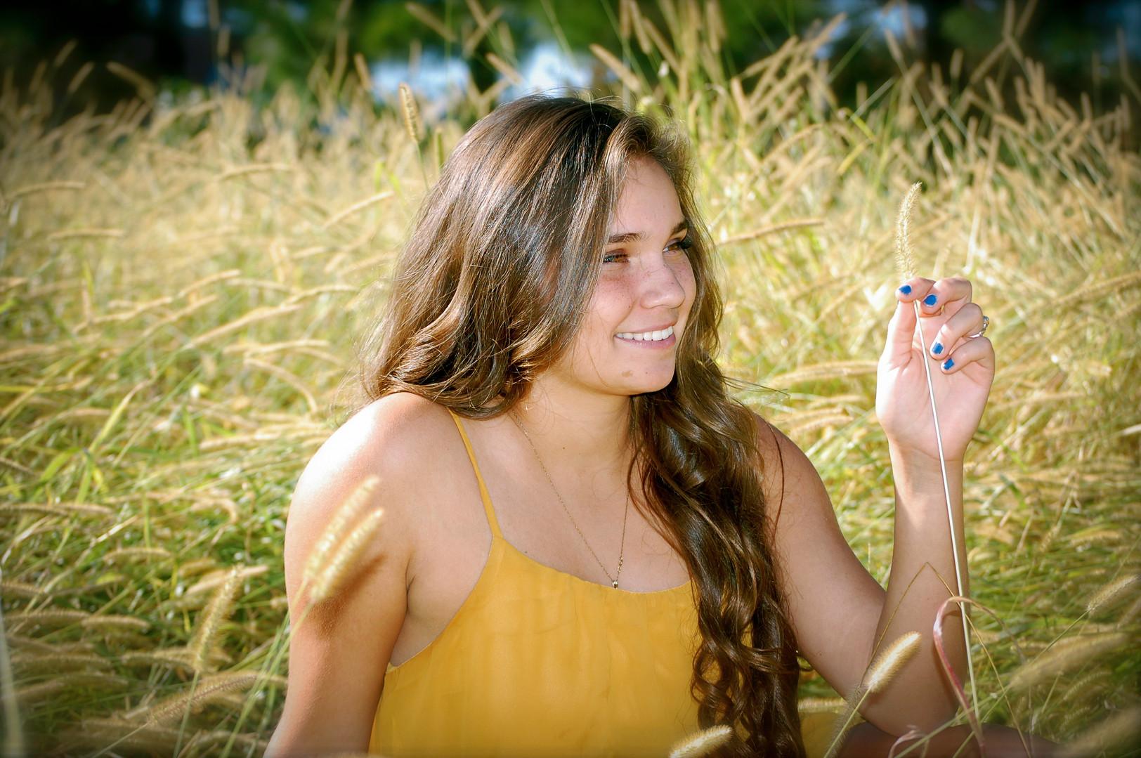 high school senior girl  golden field