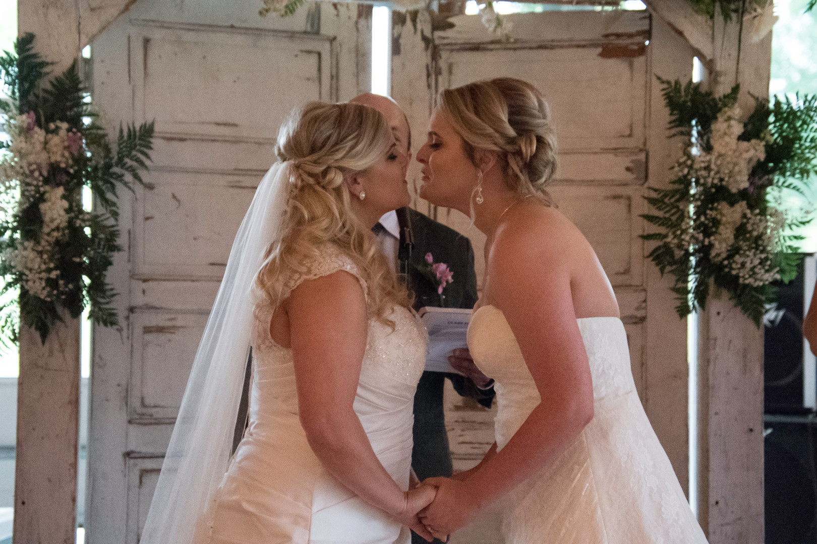 brides, kiss, wedding, purple, white, rustic