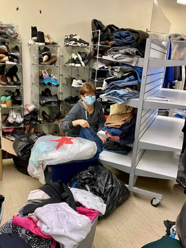 Meredith Is in her happy place sorting and organizing our clothing donations.