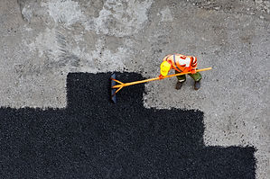 Aerial view of road worker repair asphal