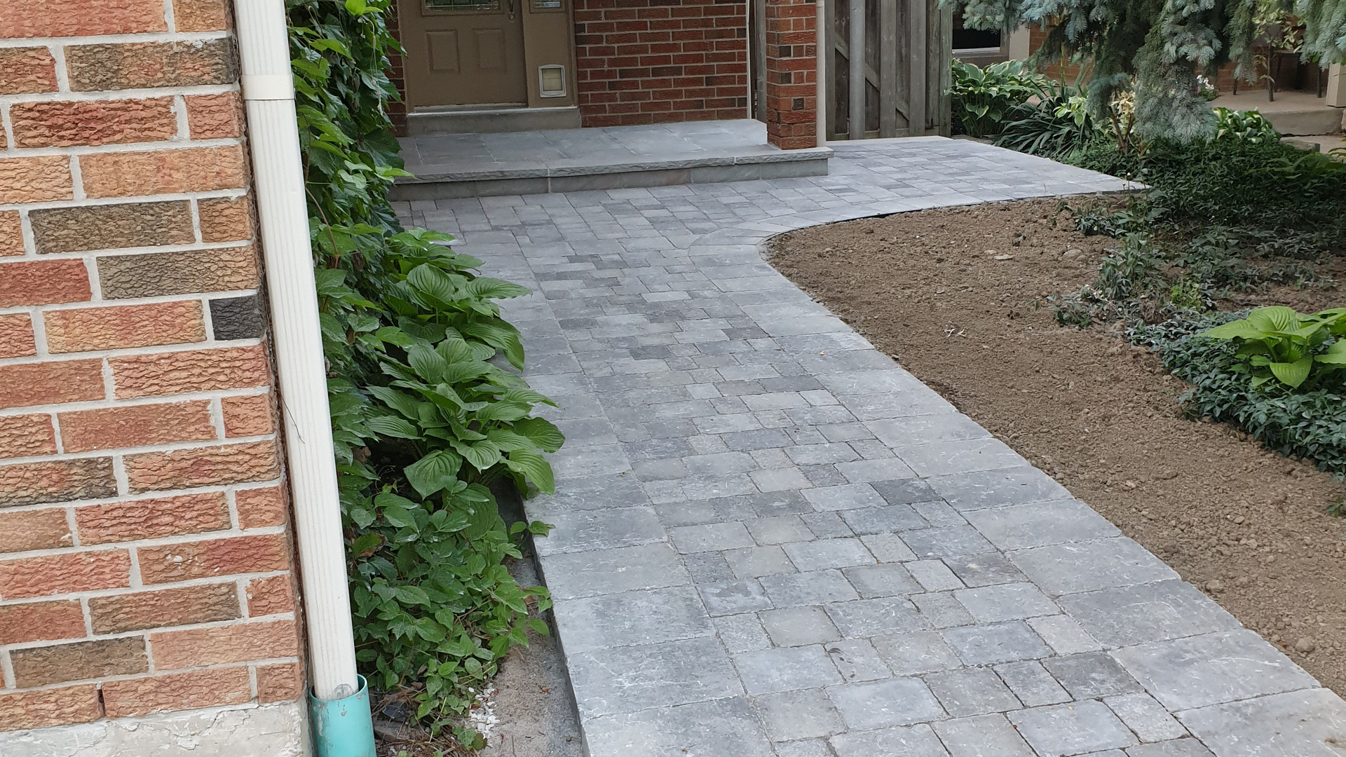 interlock walkway and flagstone porch installation