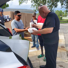 Distributing Meals at Gas Station