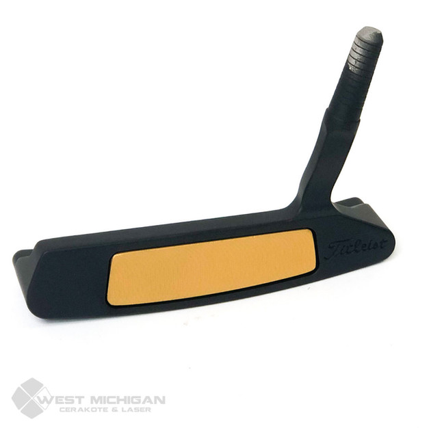 gold & black golf club.jpg