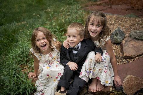 Arvada outdoor family photo shoot, siblings laugh together