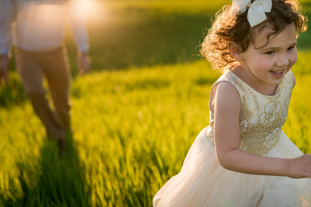 Little girl runs from dad in lifestyle family portrait session Lakewood, Colorado