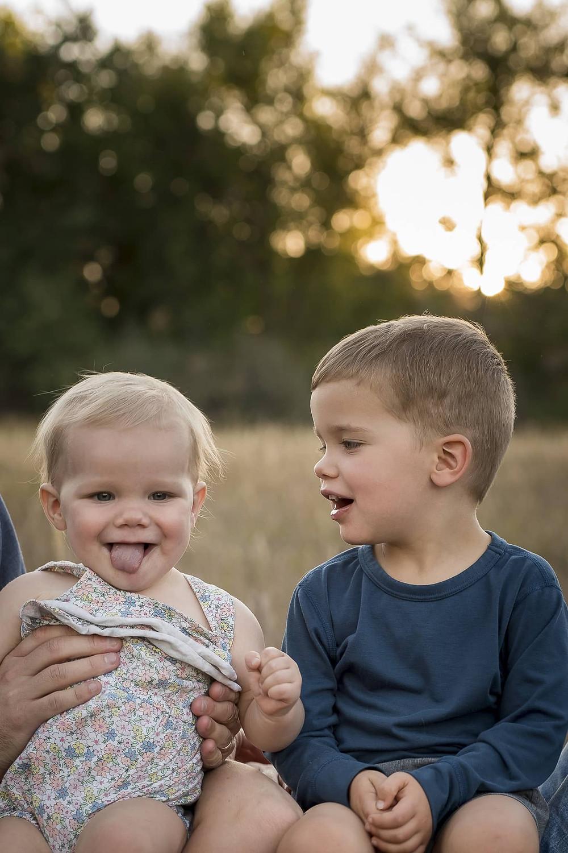 Siblings  in Colorado sunset