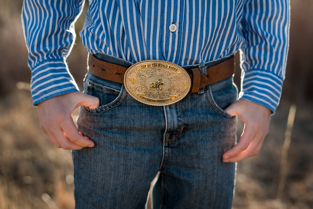 Detail shot: a boy's belt buckle from a Colorado Family Portrait session.