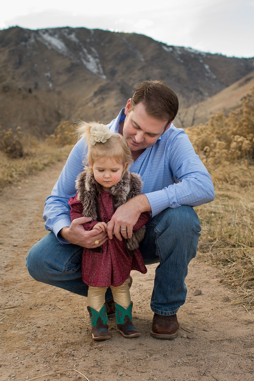 Daddy with little girl, mountain scene