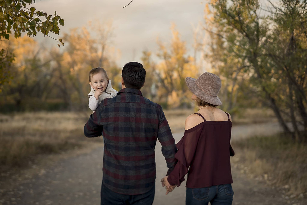 Family Photographer, Holly Freeman, captures baby over dad's shoulder in Lakewood, Colorado.