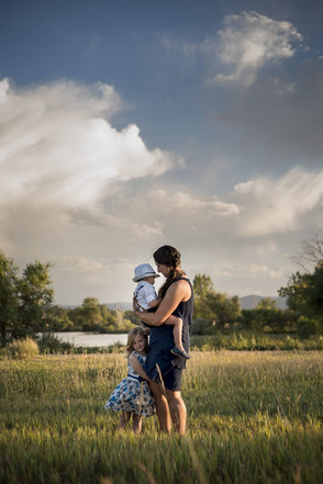 Outdoor family photo shoot, mom with children in stunning Colorado sunset