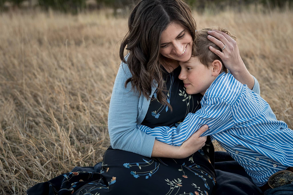 Mother and son snuggle in a Colorado Family portrait session.