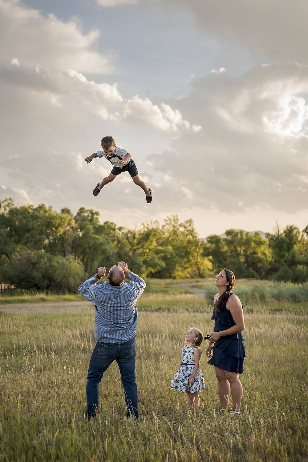 Westminster lifestyle family portrait, boy being tossed in the air