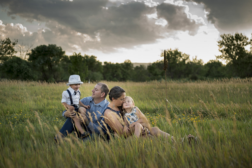 Westminster family in grass at sunset