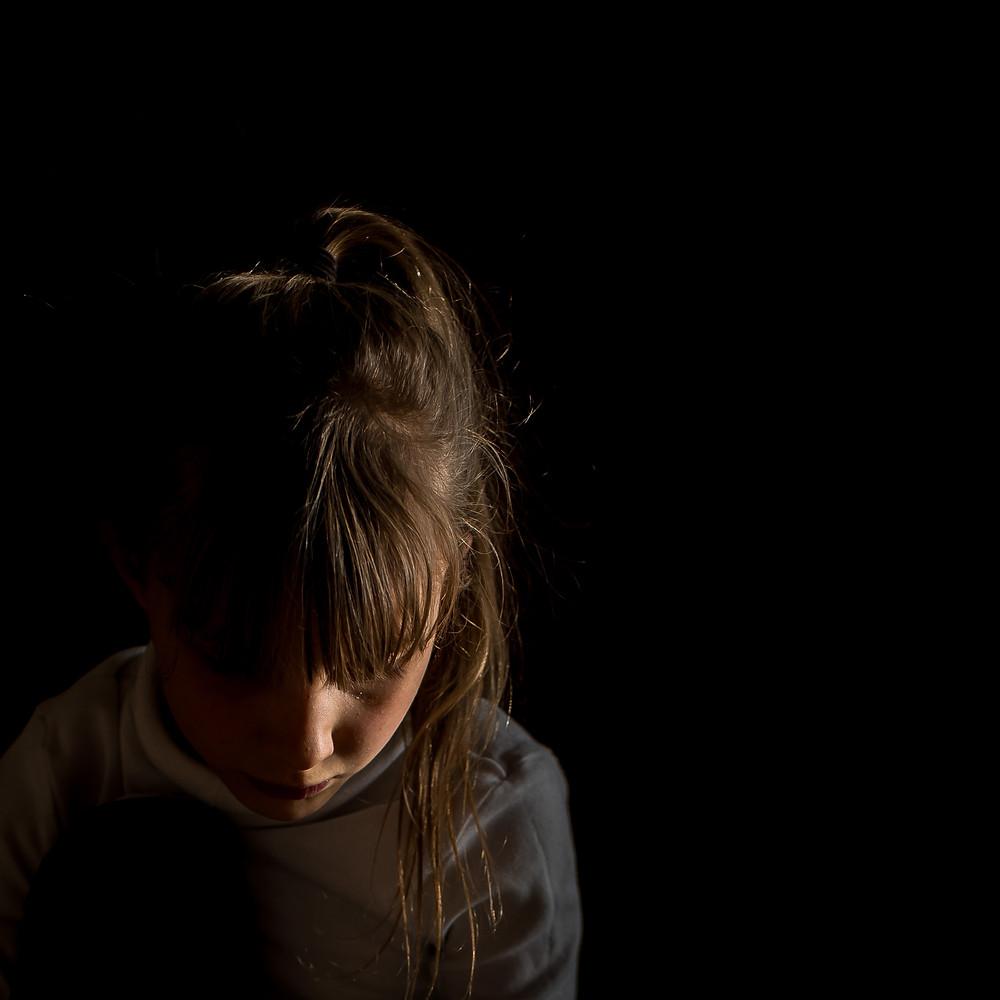 Girl in dark background