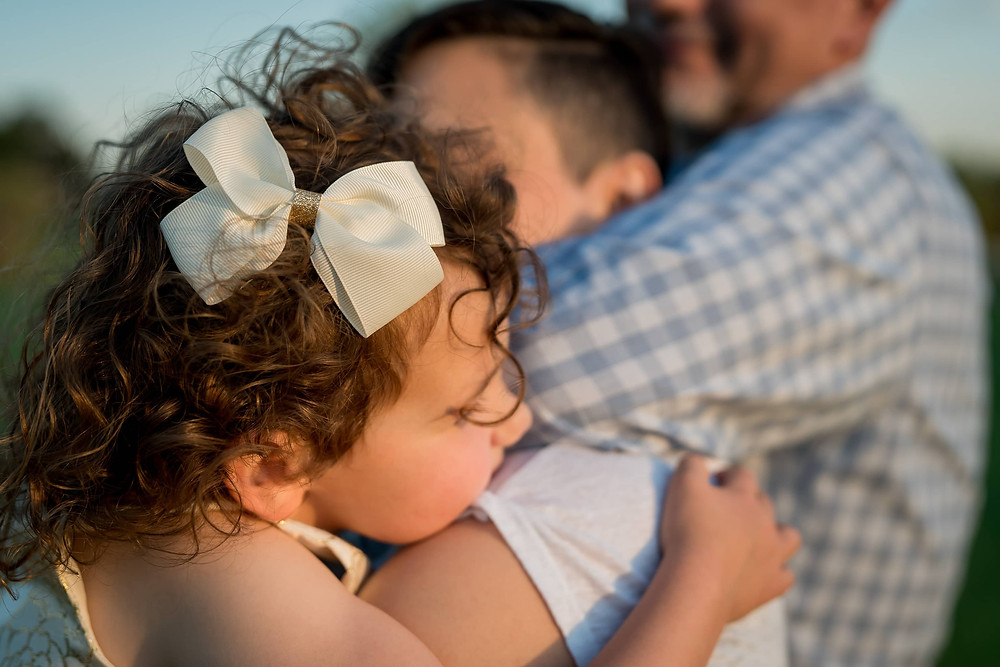 Family hug in lifestyle family portrait session in Lakewood, Colorado