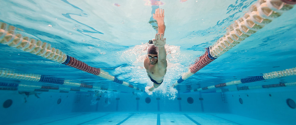 Professional man swimmer inside swimming