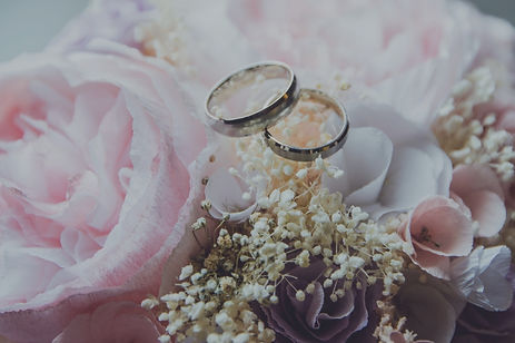 Image of Wedding Rings and Flowers