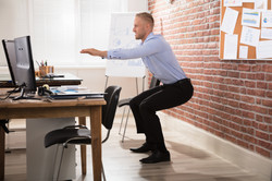 Happy Businessman Doing Exercise In Fron