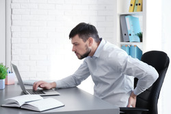 Posture concept. Man suffering from back