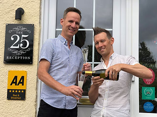 "Julian & Andy celebrating their second time winning ""Best B&B in the World!"""