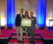 Kirstie Allsopp presenting us with our award