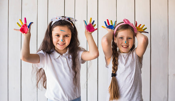 smiling-portrait-two-girls-showing-color
