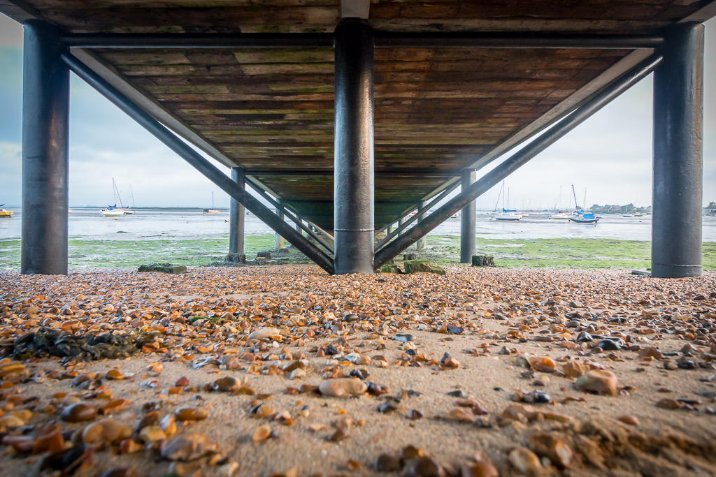 UNDER THE BOARD WALK DOWN BY THE SEA