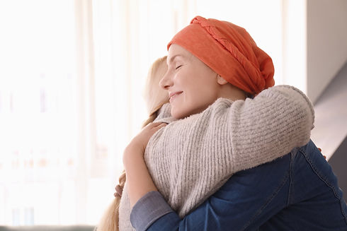 Young woman with cancer hugging her moth