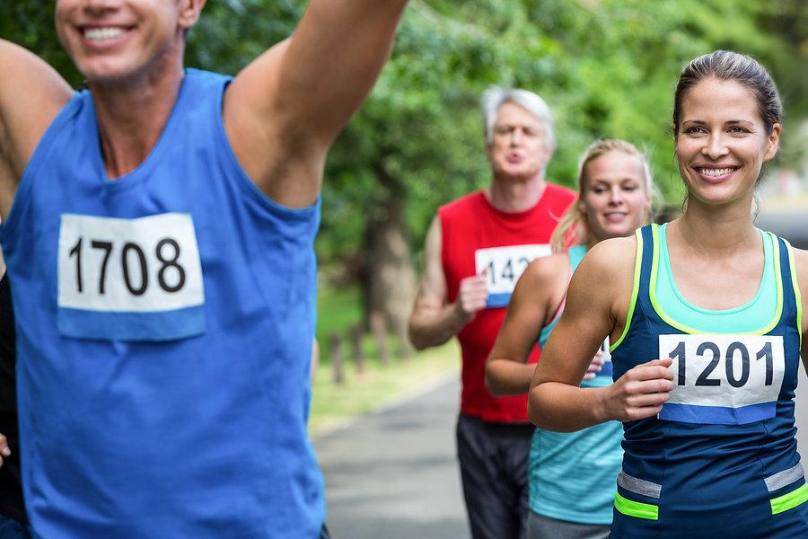 Marathon male athlete crossing the finis