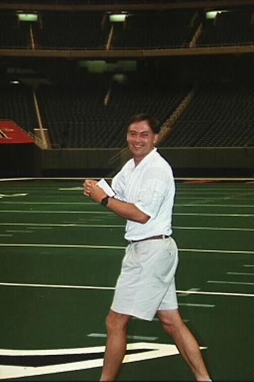 Ken Blackburn walking with paper airplane