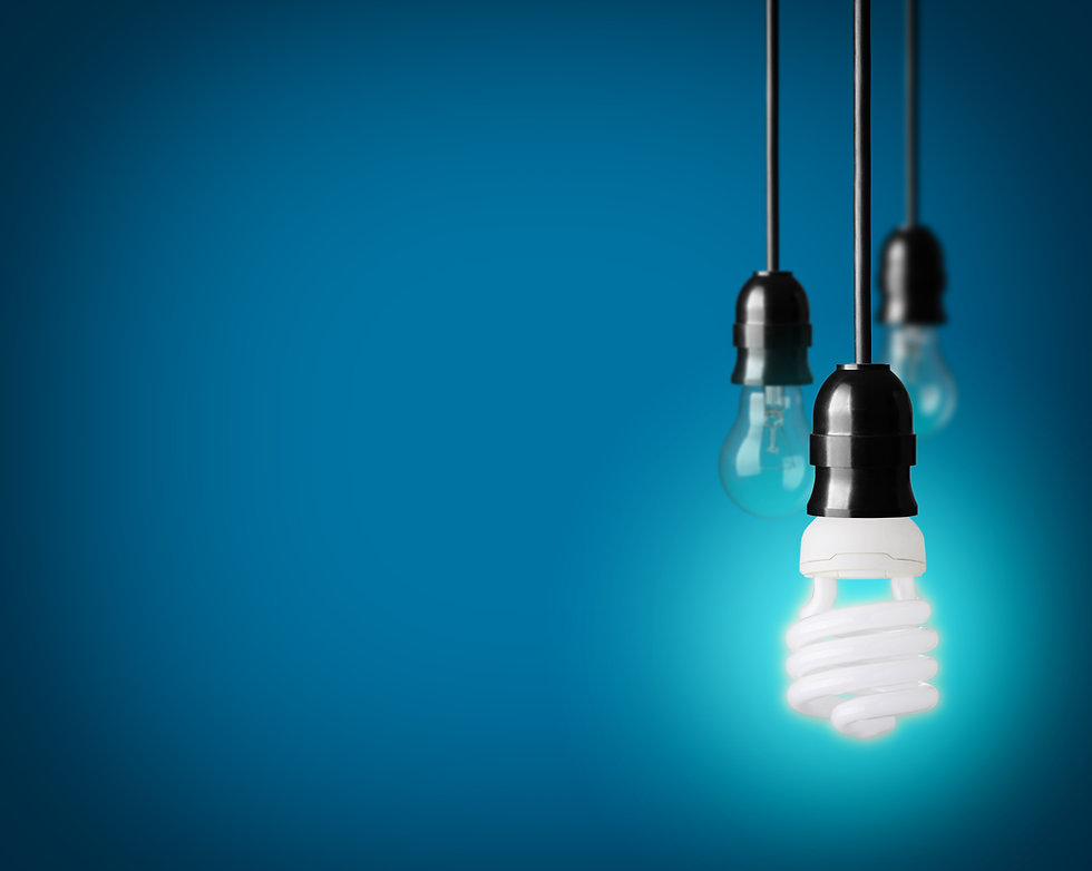 Light bulbs and energy saver bulb on blu