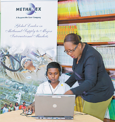 Nicholas Ramsingh, a pupil of Dow Village Government Primary School, participates in the Methanex-sponsored Arrow training programme, while class teacher, Camilla Courtney, lends support.