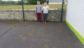 Pavement Symmetry Chalk Art