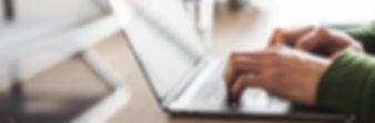 business-copywriter-typing-on-his-modern