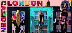 Postcard by Edward Arnold - High Street Camden elaborately decorated shop facades Camden London